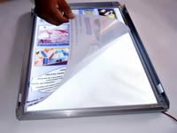 """Backlit plakatas įdėtas į reklaminį šviečiantį rėmelį """"Click"""""""